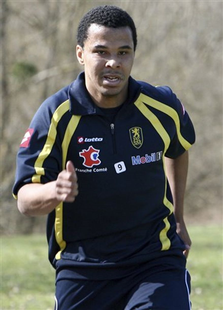 FILE - In htis March 23, 2010, file photo, FC Sochaux soccer player Charlie Davies, of the United States, jogs during a training session at the Auguste Bonal stadium in Montbeliard, eastern France. American forward Charlie Davies said he was not the driver of a car stopped for going 125 mph last weekend, but told French police he was to protect a teammate.   Davies, who nearly died in a car crash last year, told The Associated Press on Saturday, Oct. 9, 2010, that Jacques Faty, his teammate at French club Sochaux, asked him to switch places and tell police he was driving because Faty thought his license was still suspended from a previous speeding infraction. (AP Photo/Mathieu Cugnot, File)