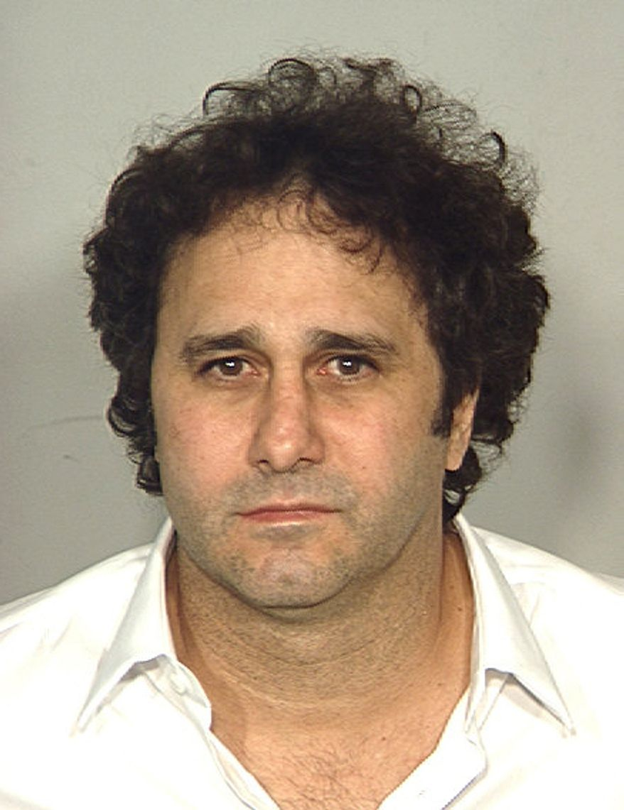 ASSOCIATED PRESS In this police booking photo released by the Las Vegas Metropolitan Police Department on Monday Oct. 11, 2010 showing George Maloof Jr. who was arrested late Saturday night, near Spanish Trail Country Club, where he lives. The owner of the Palms Casino Resort in Las Vegas says he spent a night in county jail after being arrested near his home on suspicion of drunken driving.