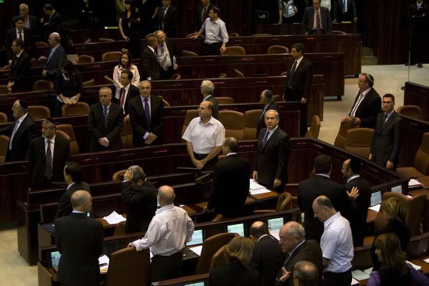 Israeli Prime Minister Benjamin Netanyahu (center right) stands during the opening of the winter session of the Knesset, Israel's parliament, in Jerusalem on Monday, Oct. 11, 2010. Mr. Netanyahu offered to renew a moratorium on Jewish settlement construction in the West Bank if the Palestinians meet his demand to recognize Israel as a Jewish state. (AP Photo/Sebastian Scheiner)