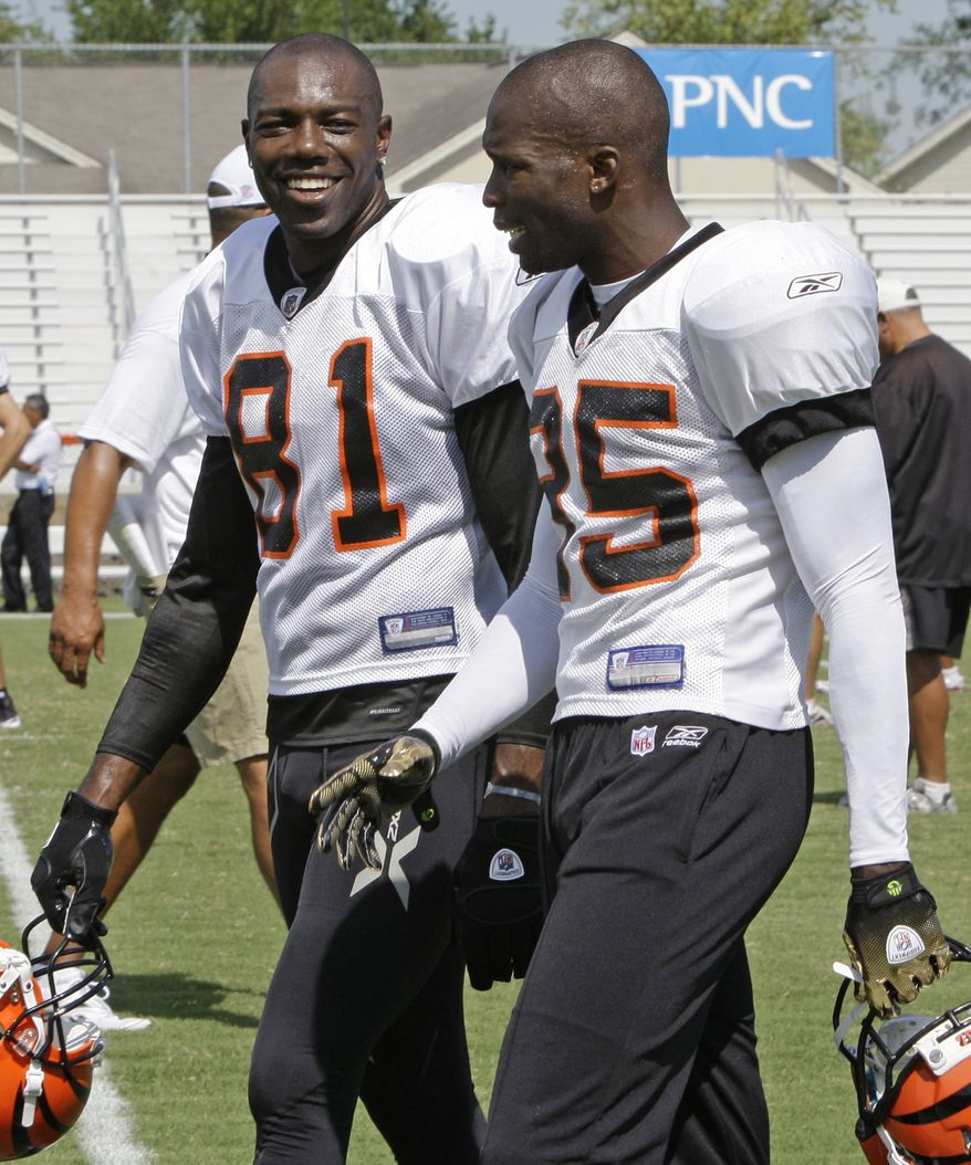 ASSOCIATED PRESS Cincinnati Bengals receivers Terrell Owens (81) and Chad Ochocinco (85) walk together during the NFL football team's practice, in this photo made Friday, July 30, 2010, in Georgetown, Ky. A new reality television show starring the two Bengals receivers debuts Tuesday on Versus.