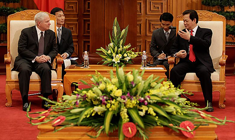 Defense Secretary Robert Gates, left,  meets with Vietnam's Prime Minister Nguyen Tan Dung in a meeting room at the Prime Minister's office in Hanoi, Vietnam, Monday, Oct. 11, 2010.  (AP Photo/Carolyn Kaster, Pool)
