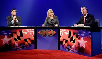 WJZ-TV anchor Denise Koch, center, moderates a debate between Maryland gubernatorial candidates former Republican former Gov. Robert Ehrlich, left, and Democratic incumbent Gov. Martin O'Malley right, in Baltimore, Monday, Oct. 11, 2010. (AP Photo/Rob Carr)