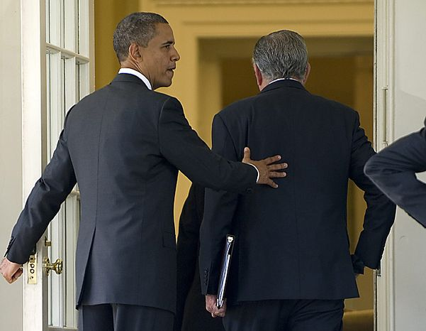 President Barack Obama puts his arm around Transportation Secretary Ray LaHood as they walk back into the Oval Office after Obama delivered a statement on transportation infrastructure, in the Rose Garden at the White House in Washington, October 11, 2010.  UPI/Kevin Dietsch