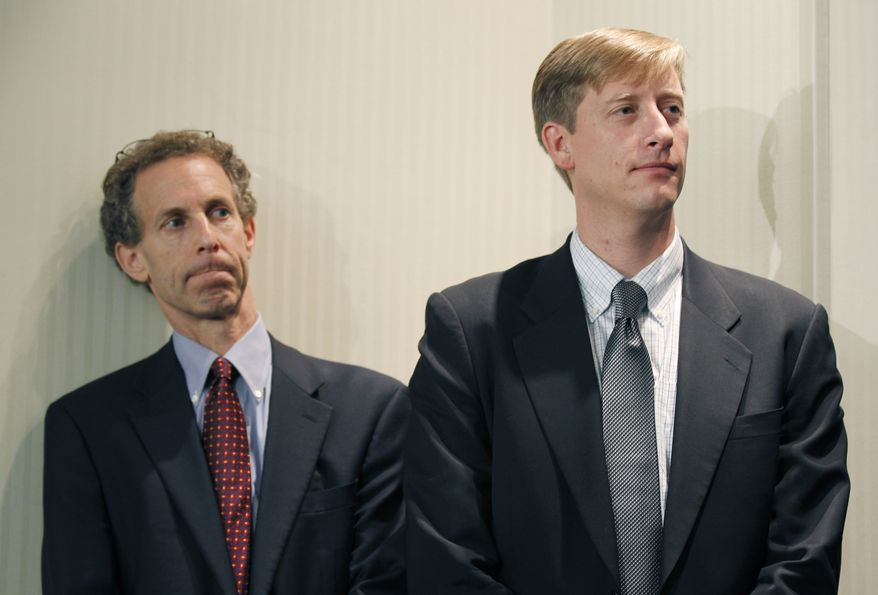A consortium of technology and investment companies including Dan Reicher, left, and Rick Needham, right, both from Google, announces that they are devoting $1.8 billion to building a network of transmission lines to connect future offshore wind farms along the Atlantic from New Jersey to Virginia, during a news conference in the National Press Club in Washington, Tuesday, Oct. 12, 2010. (AP Photo/Pablo Martinez Monsivais)