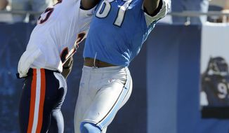 "ASSOCIATED PRESS FILE- In this Sept. 12, 2010, file photo, Detroit Lions wide receiver Calvin Johnson (81) catches a pass in the end zone over Chicago Bears cornerback Zackary Bowman late in the second half of an NFL football game in Chicago. Johnson makes a leaping grab in the end zone for what appeared to be a 25-yard TD catch that puts the Lions in the lead with 31 seconds left. But when he completes rolling over, he leaves the ball on the ground and begins celebrating. The official ruling is the player has to ""maintain possession of the ball throughout the entire process of the catch."" The Bears won 19-14."