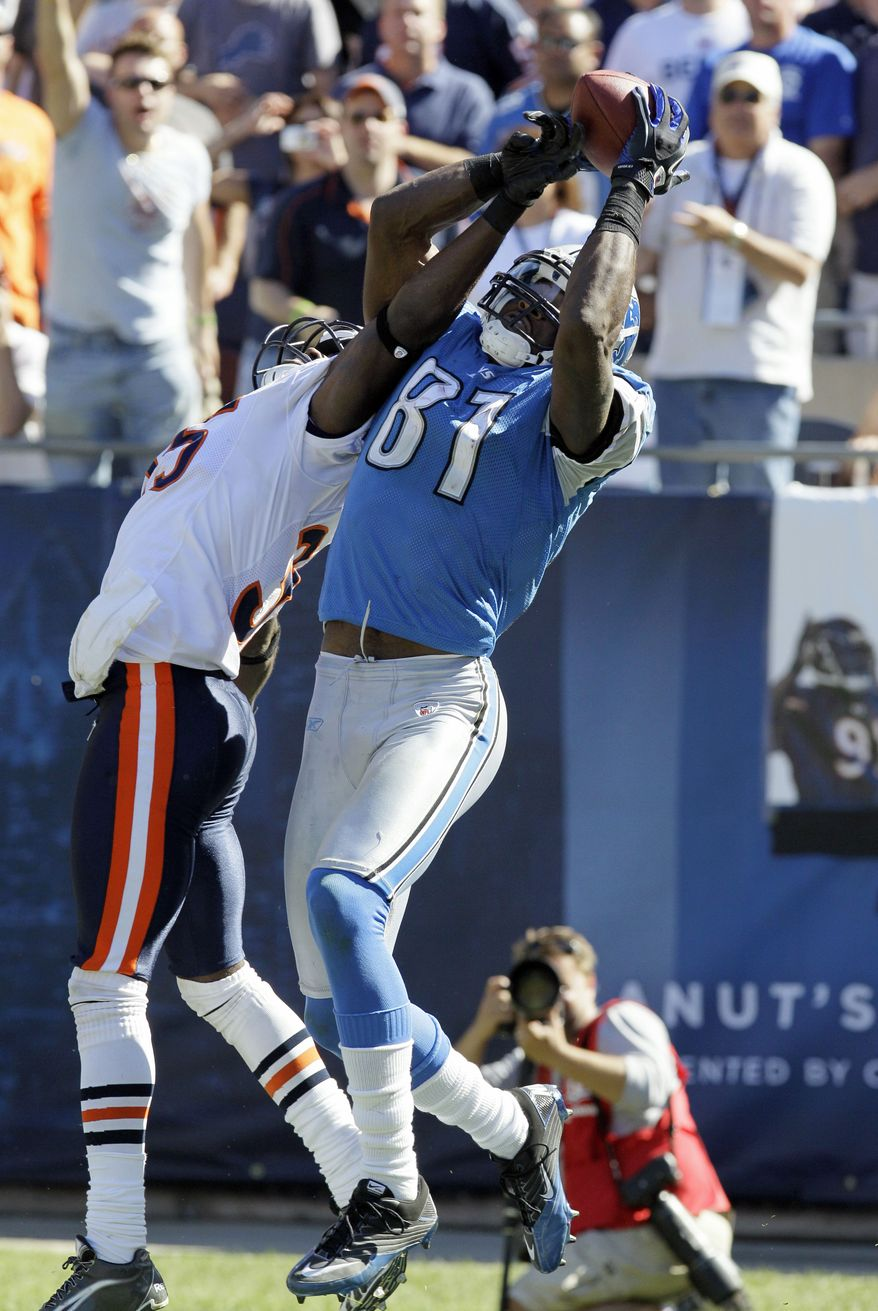 """ASSOCIATED PRESS FILE- In this Sept. 12, 2010, file photo, Detroit Lions wide receiver Calvin Johnson (81) catches a pass in the end zone over Chicago Bears cornerback Zackary Bowman late in the second half of an NFL football game in Chicago. Johnson makes a leaping grab in the end zone for what appeared to be a 25-yard TD catch that puts the Lions in the lead with 31 seconds left. But when he completes rolling over, he leaves the ball on the ground and begins celebrating. The official ruling is the player has to """"maintain possession of the ball throughout the entire process of the catch."""" The Bears won 19-14."""
