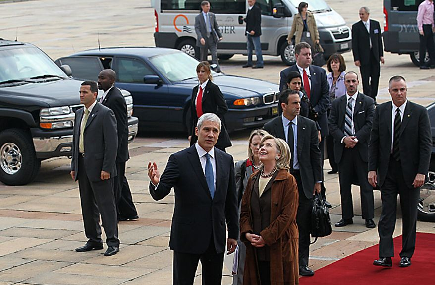 US Secretary of State Hillary Rodham Clinton, front-right, speaks with Serbian President Boris Tadic, in Belgrade, Serbia, Tuesday, Oct. 12, 2010. Clinton is visiting the Serbian capital as part of a tour of the Balkans and is pressing political reforms to the restive Balkans with the hope that such changes will lead to the region's full integration into the European Union and NATO. (AP Photo/Darko Vojinovic)