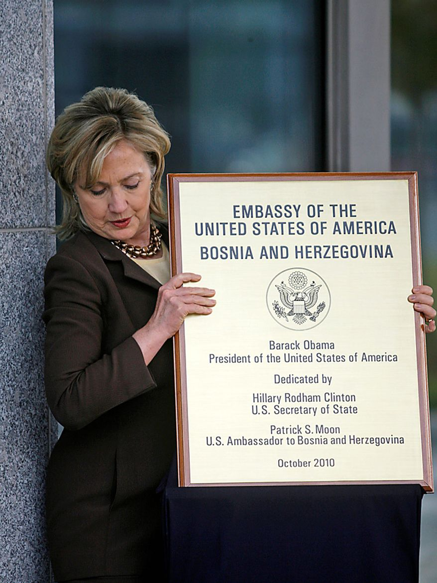 U.S. Secretary of State Hillary Clinton holds the plaque during the opening of the new U.S. Embassy in Sarajevo, Bosnia on Tuesday Oct. 12, 2010. Clinton on Tuesday challenged all sides in ethnically divided Bosnia to embrace political reform needed for European Union and NATO membership.  (AP Photo/Dado Ruvic/Pool)