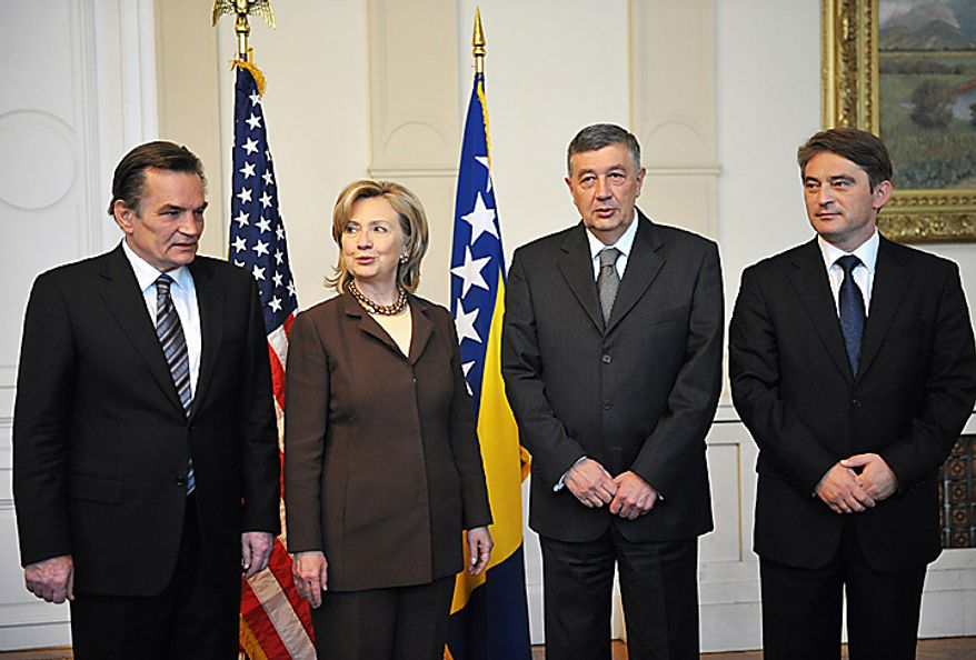 US Secretary of State Hillary Rodham Clinton is greeted by the members of the the Bosnian tri partite Presidency, Chairman Haris Silajdzic, left, Nebojsa Radmanovic, second right, and Zeljko Komsic in Sarajevo, Tuesday, Oct. 12, 2010. Secretary of State Hillary Rodham Clinton is pressing political reforms to the restive Balkans with the hope that such changes will lead to the region's full integration into the European Union and NATO. Secretary Clinton arrived late on Monday, in the capital of ethnically divided Bosnia-Herzegovina, which just held elections, to urge the country's new leadership to make EU membership a priority. (AP Photo/Mandel Ngan, Pool)