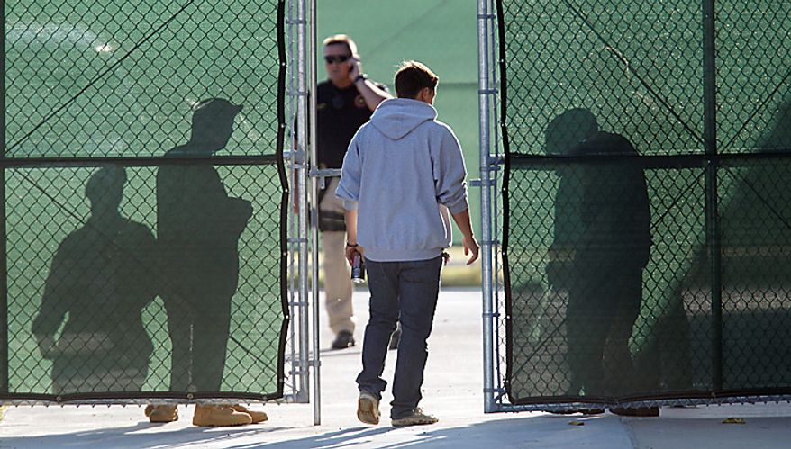 An unidentified man enters a security area at the U.S. Magistrate court where an Article 32 hearing for Maj. Nidal Malik Hasan is scheduled to be held, Tuesday, Oct. 12, 2010 in Fort Hood, Texas. Hasan, 40, is charged with premeditated murder and attempted premeditated murder in a Nov. 5 attack , which killed 13 people and wounded 32 others in a processing center where soldiers were making final preparations to deploy. The Article 32 hearing will determine whether there is enough evidence to put the Army psychiatrist on trial. (AP Photo/Eric Gay)