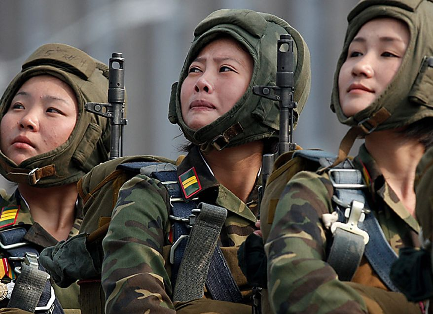 North Korean soldiers react during a massive military parade marking the 65th anniversary of the communist nation's ruling Workers' Party in Pyongyang, North Korea on Sunday, Oct. 10, 2010.  (AP Photo/Vincent Yu)