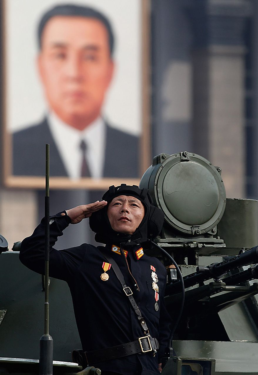 A North Korean soldier salutes during a massive military parade marking the 65th anniversary of the communist nation's ruling Workers' Party in Pyongyang, North Korea on Sunday, Oct. 10, 2010. This year's celebration comes less than two weeks after Kim Jong Il's re-election to the party's top post and the news that his 20-something son would succeed his father and grandfather as leader. (AP Photo/Vincent Yu)
