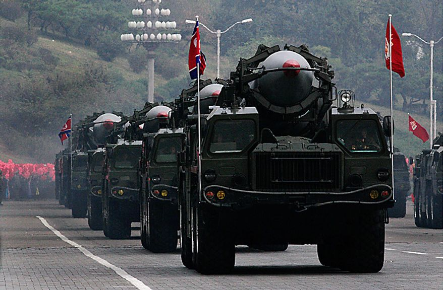 North Korea missiles on the trucks make its way during a massive military parade marking the 65th anniversary of the communist nation's ruling Workers' Party in Pyongyang, North Korea on Sunday, Oct. 10, 2010. This year's celebration comes less than two weeks after Kim Jong Il's re-election to the party's top post and the news that his 20-something son would succeed his father and grandfather as leader. (AP Photo/Vincent Yu)