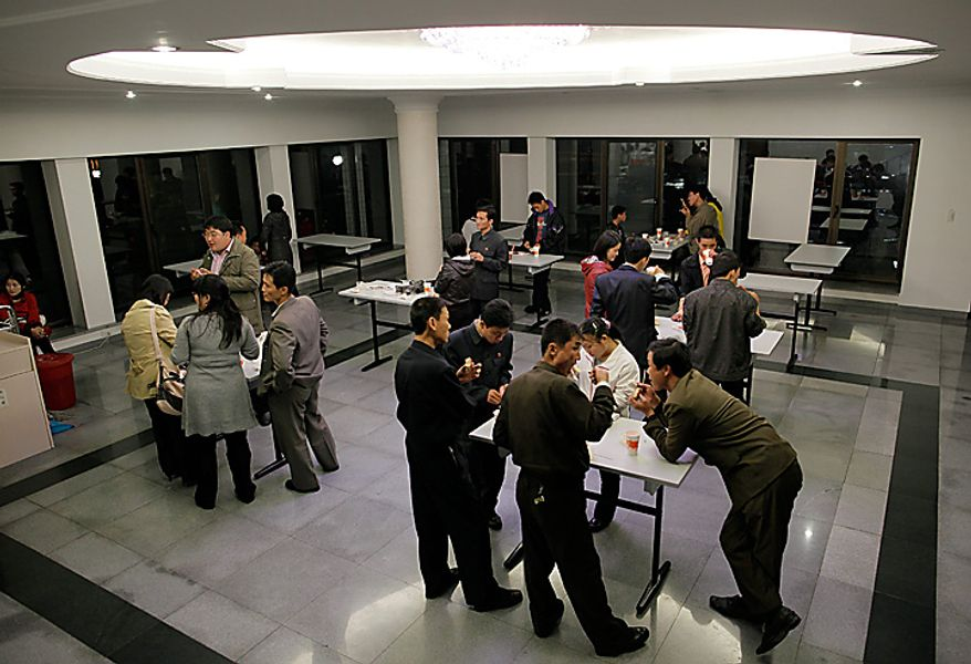 In this Monday, Oct. 11, 2010 photo, North Koreans eat at a fast food restaurant in a park in Pyongyang, North Korea.  North Koreans took a long weekend to celebrate a major political anniversary and the unveiling of leader Kim Jong Il's heir-apparent in scenes of revelry that contradicted the shortages normally associated with this reclusive country. (AP Photo/Vincent Yu)