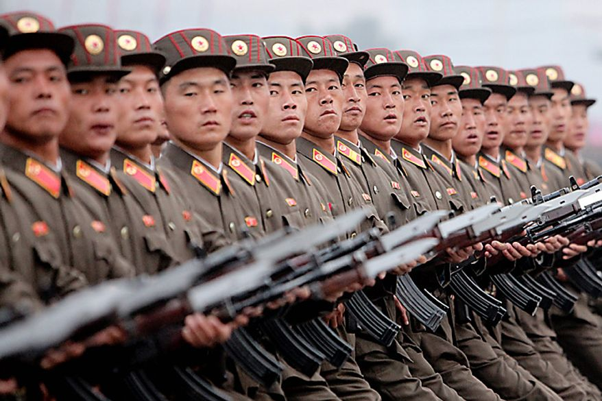 Members of the North Korean military march during a parade commemorating the 65th anniversary of the Korea Worker's Party in Pyongyang, North Korea, on Sunday, Oct. 10, 2010. North Korean heir apparent Kim Jong Un stood at his father's right side today as they reviewed troops, tanks and missiles in a Pyongyang military parade. Photographer: Dieter Depypere/Bloomberg