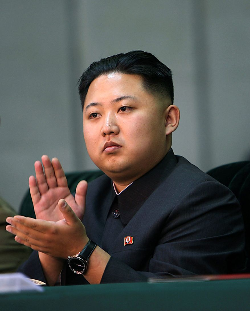 In this photo released by China's Xinhua News Agency, Kim Jong Un, the third son of North Korean leader Kim Jong Il, applauds while watching the Arirang mass games performance staged to celebrate the 65th anniversary of the founding of the Workers' Party of Korea, in Pyongyang, North Korea, Saturday, Oct. 9, 2010. (AP Photo/Xinhua, Yao Dawei)