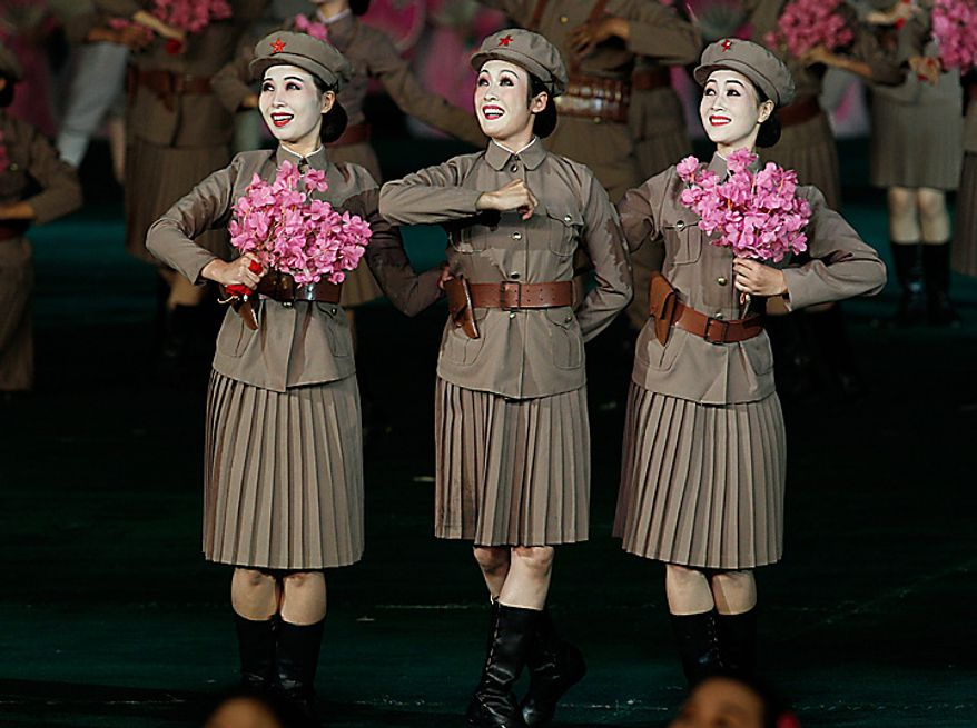 North Korean dancers perform during a Arirang mass games to mark the  65th anniversary of the communist nation's ruling Workers' Party in Pyongyang, North Korea on Saturday, Oct. 9, 2010. Leader Kim Jong Il brought dancers at the Arirang mass games to tears Saturday by making a rare appearance at the festival on the second day of celebrations in the North Korean capital. (AP Photo/Vincent Yu)