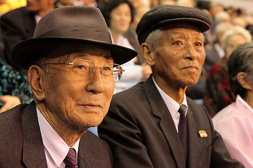 Spectators watch the annual Arirang festival at May Day stadium in Pyongyang, North Korea, on Saturday, Oct. 9, 2010. North Korea's government used one of its most visible propaganda tools -- mass performances in a Pyongyang stadium -- to demonstrate its closeness to China as the Stalinist state embarks on a leadership change. Photographer: Dieter Depypere/Bloomberg
