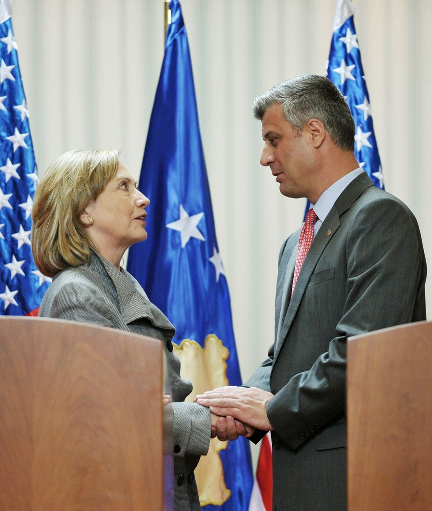 Secretary of State Hillary Rodham Clinton and Kosovar Prime Minister Hashim Thaci shake hands in Pristina, Kosovo, on Wednesday. Mrs. Clinton wrapped up a three-nation tour of the restive, ethnically splintered Balkans with a stop in Kosovo, the world's newest country. (Associated Press)