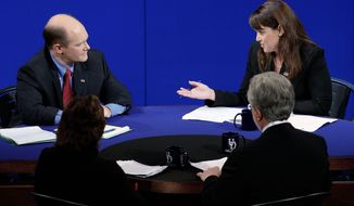 Republican Senate candidate Christine O'Donnell responds to Democratic rival Chris Coons in a nationally televised debate at the University of Delaware in Newark on Wednesday night. They are vying for the seat formerly held by Vice President Joseph R. Biden Jr. (Associated Press)