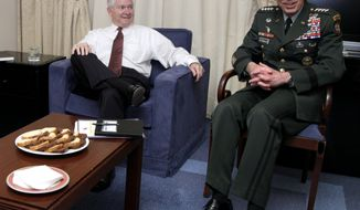 Defense Secretary Robert Gates and Gen. David Petraeus are photographed Wednesday at the beginning of a meeting in Brussels. (Associated Press/Carolyn Kaster, Pool)