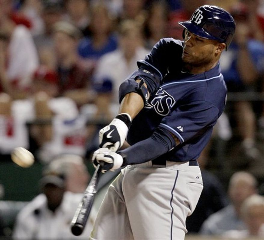 Tampa Bay Rays left fielder Carl Crawford scores a solo home run against Texas Rangers relief pitcher Neftali Feliz during the ninth inning of the American League Division Series baseball game  Saturday, Oct. 9, 2010, in Arlington, Texas. (AP Photo/Tony Gutierrez)