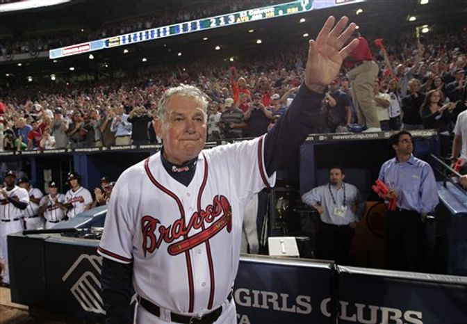 Atlanta Braves manager Bobby Cox waves to fans after a 3-2 loss to the San Francisco Giants in Game 4 of baseball's National League Division Series on Monday, Oct. 11, 2010, in Atlanta.  After a half-century in baseball, most of it in uniform, Cox must move out of the dugout.  (AP Photo/Dave Martin)