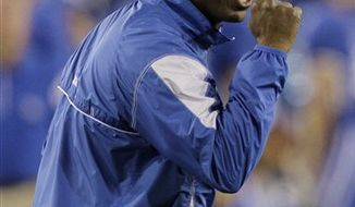 Kentucky coach Joker Phillips urges his players on during the second half of their NCAA college football game against Auburn in Lexington, Ky., Saturday, Oct. 9, 2010. Auburn won the game 37-34 on a field goal as time ran out. (AP Photo/Ed Reinke)