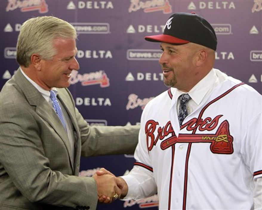 Fredi Gonzalez, left, speaks as former Atlanta Braves manager Bobby Cox looks on during a news conference where he was introduced as the team's new manager Wednesday, Oct. 13, 2010 in Atlanta. Cox retired at the end of the season. (AP Photo/John Bazemore)