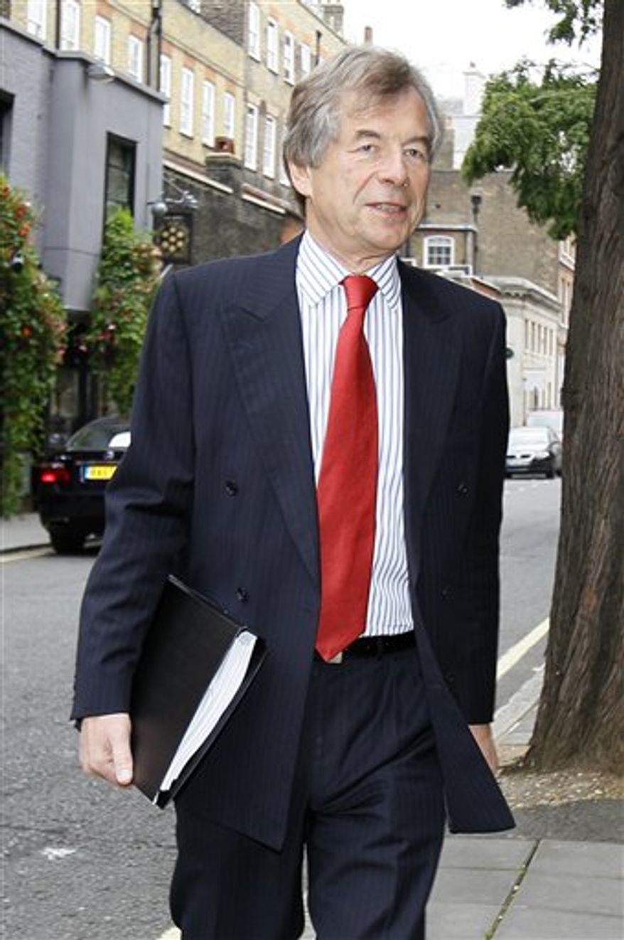 Liverpool's soccer club Chairman Martin Broughton arrives at the High Court in London, Tuesday, Oct.12, 2010. The battle for control of Liverpool went to court with a bank trying to force through the sale of the club to the owners of the Boston Red Sox over the objection of the current American owners. Royal Bank of Scotland, which holds the bulk of Liverpool's debt, is seeking a court order preventing co-owners Tom Hicks and George Gillett Jr. from removing two of the three rival board members supporting a 300 million-pound ($476 million) sale to the Boston group.(AP Photo/Alastair Grant)