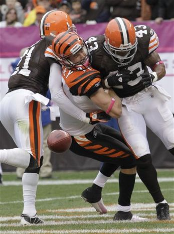 FILE- In this Oct. 3, 2010, file photo, Cincinnati Bengals wide receiver Jordan Shipley is checked by medical personnel after a hard hit from Cleveland Browns safety T.J. Ward in the fourth quarter of an NFL football game in Cleveland. The violent hit that left Shipley with a concussion was an illegal one, earning Browns safety T.J. Ward a $15,000 fine. (AP Photo/Tony Dejak, File)