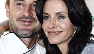 "FILE - In this Sept. 21, 2003 file photo, Courteney Cox Arquette, a star in the comedy series ""Friends,"" arrives with her husband David Arquette for the 55th Annual Primetime Emmy Awards at the Shrine Auditorium in Los Angeles. (AP Photos/Laura Rauch, file)"