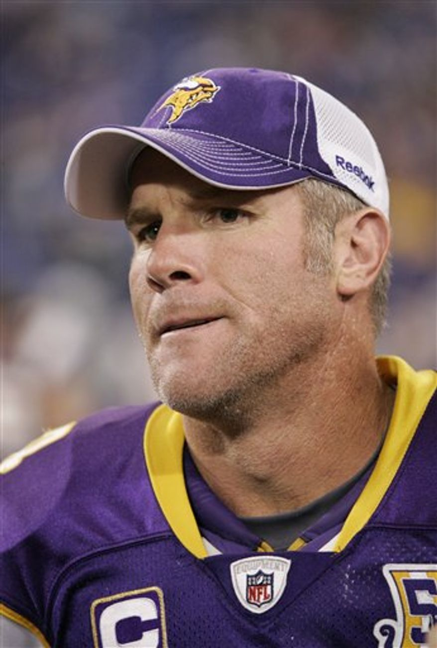 FILE - This Sept. 26, 2010, file photo shows Minnesota Vikings quarterback Brett Favre being interviewed after an NFL football game against the Detroit Lions,  in Minneapolis. With the NFL investigating whether he sent lewd photos of himself to a Jets game hostess while he played for New York in 2008, Favre said Wednesday, Oct. 13, 2010,  that his cherished, league-record streak of 289 straight starts could be in danger if the pain in his right elbow gets any worse.(AP Photo/Andy King)