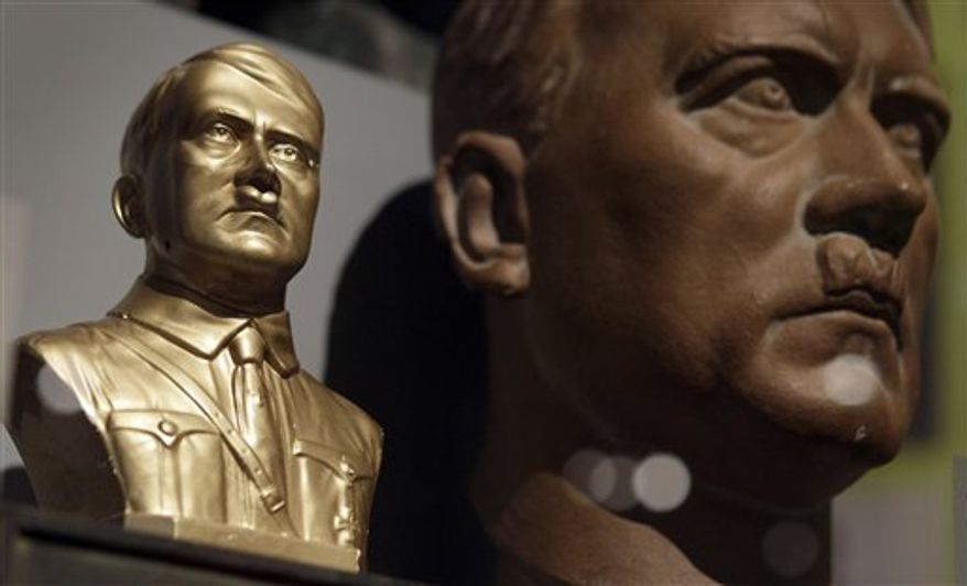 A bust of Adolf Hitler is pictured in front of a portrait of Hitler during a preview for the exhebition 'Hitler and the Germans - nation and crime' in Berlin, Germany, Wednesday, Oct. 13, 2010. The exhibition runs from Oct. 15, 2010 until Feb. 6, 2011. (AP Photo/Michael Sohn)