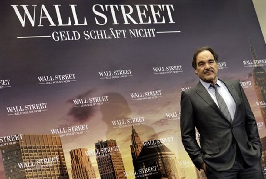 """**FILE** Director Oliver Stone poses for the photographers during a photo-call for the movie """"Wall Street: Money Never Sleeps"""" in Berlin on Oct. 12, 2010. (Associated Press)"""