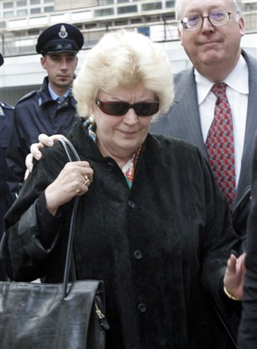 FILE-  In this Wednesday, Nov. 16, 2005 file photo, former curator of the J. Paul Getty Museum in California Marion True is escorted by an unidentified lawyer as she leaves a Rome courtroom.  A Rome judge on Wednesday, Oct. 13, 2010, declared an end to the six-year-old trial of a former J. Paul Getty Museum antiquities curator Marion True, a case that followed with concern by museums worldwide, because the statute of limitations had expired, defense lawyers said. The case against True involved about 35 artifacts acquired by the museum between 1986 and the late 1990s, including bronze Etruscan pieces, frescoes and painted Greek vessels. (AP Photo/Pier Paolo Cito, File)