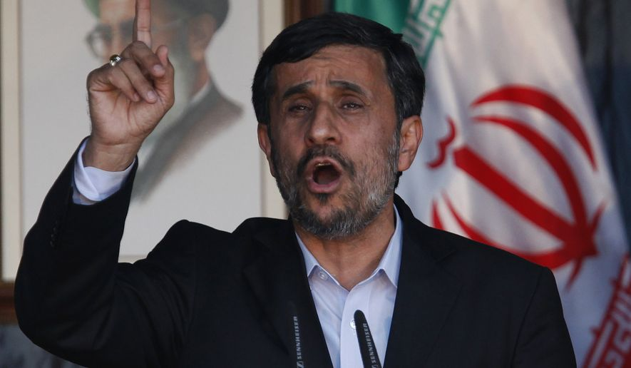Iranian President Mahmoud Ahmadinejad gestures to his supporters during a rally organized by Hezbollah in the southern border town of Bint Jbeil, Lebanon, on Thursday Oct. 14, 2010. (AP Photo / Hussein Malla)