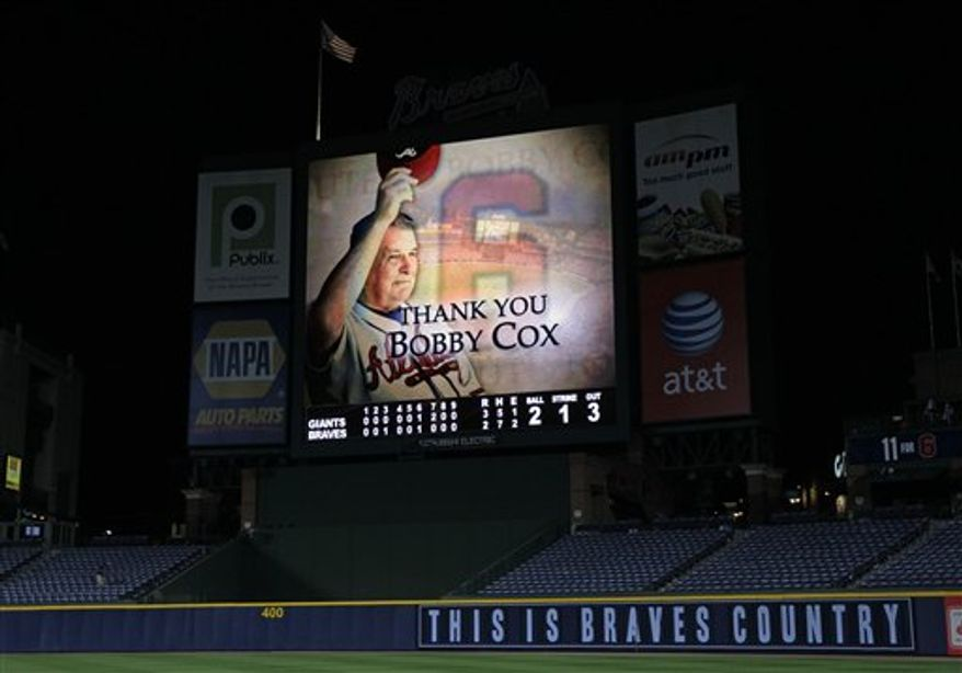 Atlanta Braves manager Bobby Cox waves to fans after a 3-2 loss to the San Francisco Giants in Game 4 of baseball's National League Division Series on Monday, Oct. 11, 2010, in Atlanta.  (AP Photo/Dave Martin)