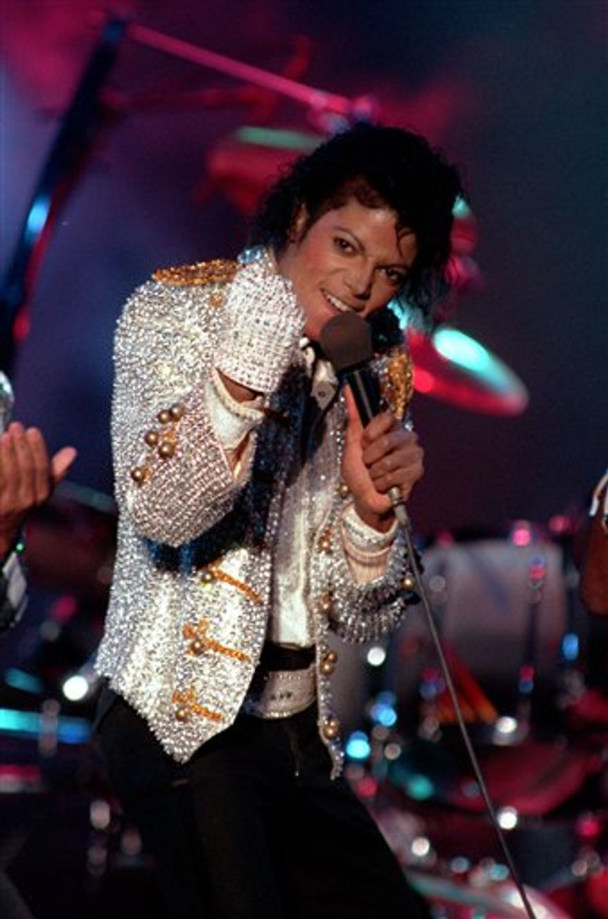 """FILE - In this Dec. 3, 1984 file photo, Michael Jackson performs with his brothers at Dodger Stadium in Los Angeles. Michael Jackson fans can get his entire video collection for the holiday season, including a video never released for his song """"One More Chance.""""The """"Michael Jackson's Vison"""" boxed set is due for release Nov. 22 and includes four and a half hours worth of material, including the fully restored version of """"Black or White."""" (AP Photo/Doug Pizac, File)"""