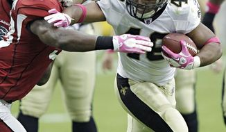 New Orleans Saints' Drew Brees (9) flips the ball back to the referee after a penalty was called on the Saints during the first quarter in an NFL football game against the Arizona Cardinals Sunday, Oct. 10, 2010, in Glendale, Ariz. (AP Photo/Ross D. Franklin)