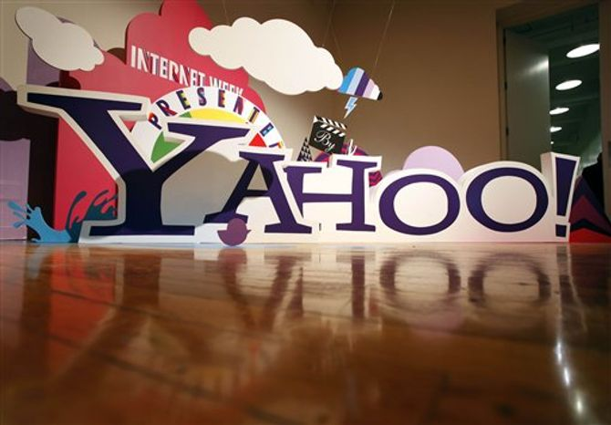 FILE - This file photo made June 7, 2010, shows a sign for Yahoo! in New York. Investors are running up the price of Yahoo shares Thursday, Oct. 14, 2010, after a report saying AOL and a group of private equity firms may bid for the Web company. (AP Photo/Mark Lennihan, file)