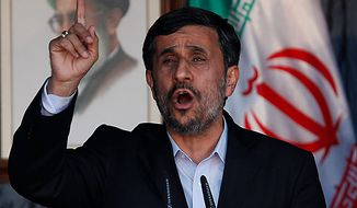 Iranian President Mahmoud Ahmadinejad gestures to his supporters during a rally organized by Hezbollah in the southern border town of Bint Jbeil, Lebanon, on Thursday Oct. 14, 2010. Thousands of Hezbollah supporters jammed a stadium in southern Lebanon Thursday ahead of a visit by Iranian President Mahmoud Ahmadinejad that will take him to within a couple miles of the Israeli border, a trip that the U.S. and Israel have called intentionally provocative. (AP Photo / Hussein Malla)