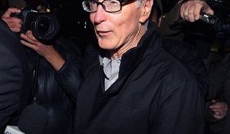 US principal owner of the Boston Red Sox, John W Henry, gestures as he leaves a law firm in London, Thursday, Oct. 14, 2010. Liverpool's board of directors won the latest court battle in the drawn-out attempt to sell the club to the owners of the Boston Red Sox on Thursday, leaving the current American owners with slim hopes of using the Texas legal system to block the deal. On a second successive day of legal wrangling on both sides of the Atlantic, a British High Court judge granted an injunction against co-owners Tom Hicks and George Gillett Jr., ordering them to withdraw their legal action in a Dallas district court.  (AP Photo Dominic Lipinski/PA)