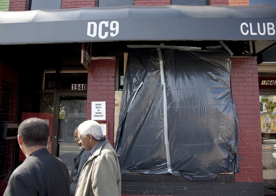** FILE ** The front window of the DC9 nightclub in Washington, is covered on Friday, Oct. 15, 2010. (AP Photo/Evan Vucci)