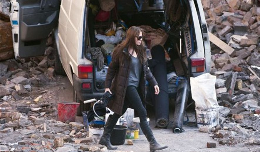 US actress Angelina Jolie walks in a scene during the shooting of her directorial debut, a film called 'Untitled Bosnian War Love Story' in Budapest, Hungary, Thursday, Oct. 14, 2010. The movie,  about a young Serb and a Muslim woman who fall in love just  before beginning of the Bosnian war, is due to be released in 2011.  (AP Photo/MTI, Bea Kallos)