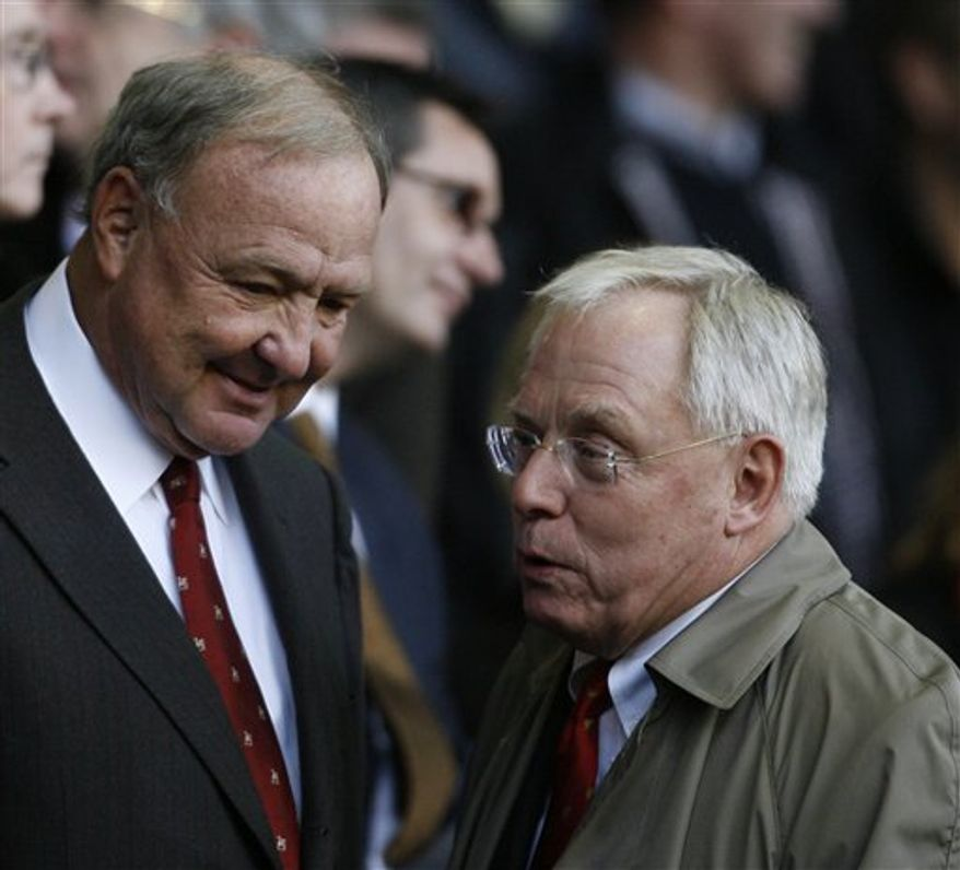 FILE - This April 21, 2009, file photo shows Liverpool co-owners Tom Hicks, left, and George Gillett before an English Premier League soccer match between Liverpool and Arsenal in Liverpool, England.   Liverpool's ownership battle returned to the High Court on Thursday, Oct. 14, 2010, with lawyers questioning the validity of an injunction granted a day earlier by a Texas judge blocking the club's sale to the owners of the Boston Red Sox. (AP Photo/Paul Thomas, File)