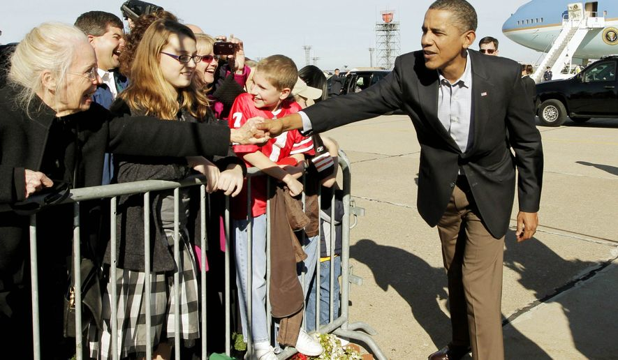 HELP WANTED: President Obama greets supporters Sunday on his arrival in Cleveland, the first stop of the day in tandem campaigning with first lady Michelle Obama for Democratic candidates in Ohio, a key state for his party. (Associated Press)