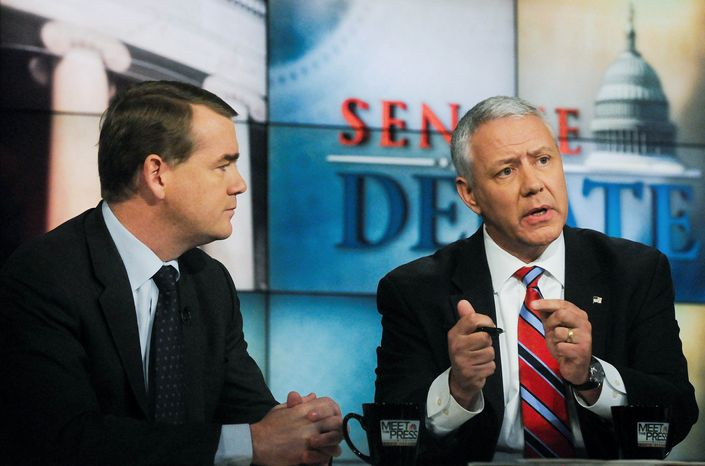 """Sen. Michael Bennet (left), Colorado Democrat, listens to his Republican challenger, Ken Buck, during a debate on """"Meet the Press."""" Mr. Buck insisted that he hasn't abandoned conservatives in favor of appealing to moderate voters. (NBC via Associated Press)"""