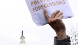 **FILE** In this photo from March 10, 2009, victims of foreclosure and their supporters take part in a rally on Capitol Hill in Washington. (Associated Press)