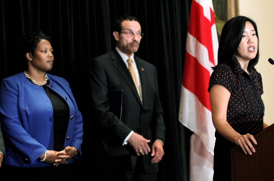 D.C. Public Schools Chancellor Michelle A. Rhee (right) accompanied by City Council Chairman Vincent C. Gray and Deputy Chancellor Kaya Henderson, announced Wednesday that she is resigning. (Associated Press)